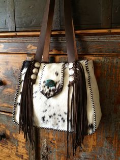 Little Big Bonnie. In summer white with Indian head and buffalo nickel conchos. Turquoise stone, fringe and fully lined. See more at gowestdesigns.us