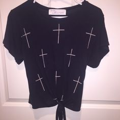 Cross T-shirt Cross t-shirt. Size small. I believe it's from urban outfitters. Got this as a gift a while back and wore it once. excellent condition. Ties in the front. ✨ feel free to make an offer/ trade/ ask questions✨ Urban Outfitters Tops Tees - Short Sleeve