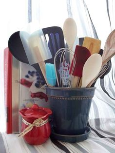 Flower pots make great utensil holders. | 27 Clever Ways To Use Everyday Stuff In The Kitchen