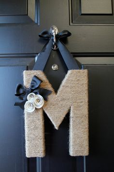 Monogram wreath. What a great idea to just put a hook on the door and hang the wreath that way!
