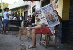 A man reads a newspaper with front page headlines about the death of Nobel laureate Gabriel Garcia Marquez, in Aracataca, the town were he was born in Colombia's Caribbean coast. Garcia Marquez died in Mexico City on Thursday.