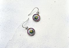 Yellow flower design silver colored dangle glass cabochon by Anchy, $7.50