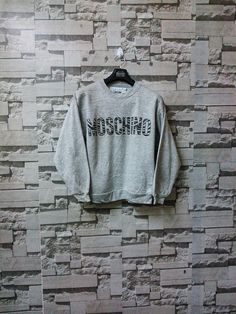 382890a5 Vintage Moschino sweatshirt made in italy by cheap and chic spellout big  logo Gianni versace Gucci Vivien Westwood Alexander McQueen ysl