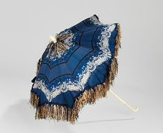 Parasol Date: 1850–59 Culture: American Medium: silk, metal, wood, ivory Dimensions: 23 5/8 in. (60 cm) Credit Line: Brooklyn Museum Costume Collection at The Metropolitan Museum of Art, Gift of the Brooklyn Museum, 2009; Gift of Dr. Robert G. Thorpe in memory of Nellie Marvin Peet, 1966 Accession Number: 2009.300.3297