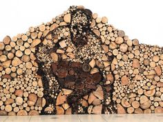 Wood Pile Art: When Chopping Logs Isn't Challenging Enough      Anyone who has ever meticulously stacked a wood pile knows that there's an art to stacking logs, but can a wood pile itself be a work of art? You betcha. Hungarian artist Gyula Várnai created this wonderful installation that depicts a man crouching down made entirely out of logs.
