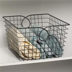 Spectrum's Teardrop Large Basket provides a simple and effective storage solution for any room in the home. Organize your kitchen or bathroom cabinets, the pantry closet, or the office. Convenient handles allow for easy transportation from room to room. Made of sturdy steel, this basket will help declutter your home in an instant with its endless amount of storage options.