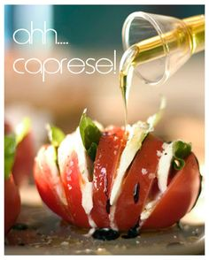 "Take a whole tomato and cut slices into it (about 1/4″ thick) without cutting all the way thru the other side. Insert a slice of fresh mozzarella cheese and a basil leaf in between each slice. Once the tomato is stuffed (it should ""fan"" out a bit) drizzle olive oil and balsamic vinegar over the top. Drizzle it with your favorite sea salt – and voila! An update to everyone's favorite caprese salad!"