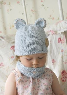 Baby mouse hat and cowl set for your little one! Find this pattern and more inspiration at LoveKnitting.