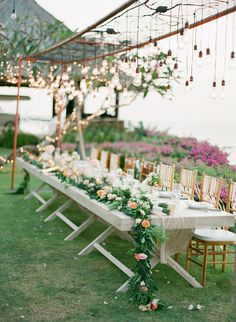#tablescapes, #garland Photography: Jemma Keech - jemmakeech.com Read More: http://www.stylemepretty.com/2014/09/11/romantic-cliff-top-wedding-by-the-sea-in-bali/