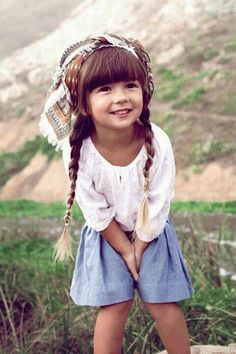one of the cutest kids i've ever seen. her whole look. my kids will dress like this.