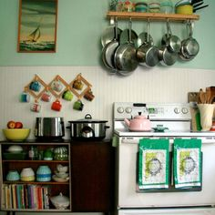 Small yet fabulous. Love the coat rack for coffee cups and a book shelf as storage.