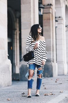 The Best Blogger Street Style for Spring Outfit Inspiration | 'Dulceida' blogger in off-the-shoulder striped sweater, distressed jeans, and flats