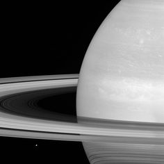Mimas (near lower left) appears tiny by comparison, so it might seem that Saturn's rings would be far more massive, but scientists think the rings are no more than a few times as massive as Mimas, or perhaps just a fraction of its mass. Cassini is expected to determine the mass of Saturn's rings to within just a few hundredths of Mimas' mass by tracking radio signals from the from the spacecraft as it flies close to the rings. Mimas is 246 miles (396 kilometers) wide.