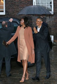 United States President Barack Obama and his wife Michelle, arrive at Kensington Palace in...