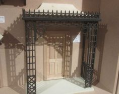 Single Gate  Posts not included 170mm high x 84mm wide 6 3/4 h x 3 3/8 w  Laser cut supplied unpainted Supplied by DHD Dolls House Direct.   Post and Packaging for UK mainland only  We do post Worldwide send us your address so we can quote you postage