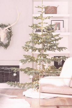 #Types #of #christmas #trees #owens #different christmas different ornaments handmade blanket simple lights skirt white owens davis types tree star and A Simple White Christmas  Owens and Davis Different types of white lights handmade white star ornYou can find Types of christmas trees and more on our website Decor Scandinavian, Scandinavian Christmas, Modern Christmas, Rustic Christmas, Beautiful Christmas, Minimalist Christmas Tree, Vintage Christmas, Christmas Mantles, Christmas Porch