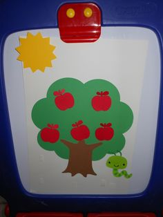 Apple tree with Mr. Slinky worm.  Tune of 5 little monkeys swinging in the tree.  This is just cardstock cutout and Velcro so the apples and worm will stick.