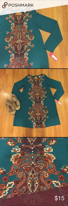 NWT Gorgeous Teal Dress This long sleeve dress is a beautiful teal color with a rust, burgundy, and cream pattern down the front and back. Cute open back detail! This dress is lined and 100% Polyester. Xhilaration Dresses