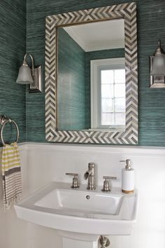 Powder Room reveal. Spoon flower green grasscloth wallpaper and West Elm Parsons mirror.