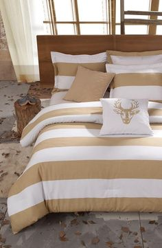So chic! Love this tan and white stripe bed set.