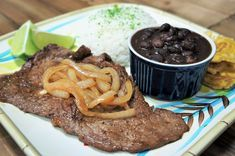 Bistec de Palomilla is the quintessential Cuban meal. It's popular in both Cuban restaurants and in homes. Palomilla steak is top sirloin. Traditionally it's cut super thin, generously seasoned and pan fried. Thin Steak Recipes, Cuban Recipes, Onion Recipes, Meat Recipes, Cooking Recipes, Paleo Recipes, Appetizer Recipes, Yummy Recipes, Sirloin Tip Steak