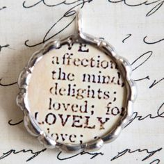 dictionary page pendant: use bottle cap and clear pebble or glaze. Frame page for glass pendants.