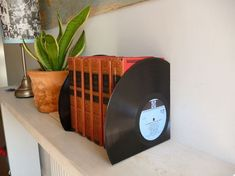 how to upcycle old vinyl records, design d cor, repurposing upcycling, Vinyl Bookends Records Diy, Best Vinyl Records, Old Records, Vinyl Record Art, Vinyl Art, Record Decor, Diy Recycling, Upcycle, Repurposing