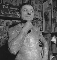 The great tattoo artist Charlie Wagner strikes a thoughtful pose in this photo from the early 1940's. #TattooHistory #VintageTattoos #TattooArtists #VanishingTattoo