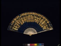 1820-1830. France. Silk appliqué, embroidered with copper-gilt thread and spangles, insertion of silk net, with carved and pierced ivory sticks and guards decorated with silver foil