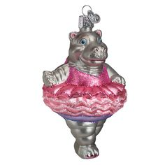 This whimsical glass ornament was carefully mouth-blown into a finely crafted mold. Then a hot solution of liquid silver was poured inside. Finally, the ornament was delicately hand-painted with many brightly colored lacquers and glitters for you to enjoy! #twinkletoes #hippoballet #ballerina #ballet #hippo #pinkchristmas #prettyinpink #funornaments #glassornaments #oldworldchristmas  Twinkle Toes (Item #12125)