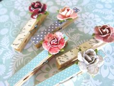 Paper Rose Clothespins 1 would be very pretty used with a chicken wire frame, or pinned to a vertical wide piece of ribbon as an inspiration board piece with pretty pictures