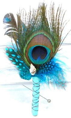 Beachy (look at the cute little shell!!) and peacock feather boutonniere -- best of both worlds