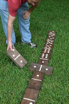 20+ DIY Yard Games that are perfect for summer entertaining, like these Giant Lawn Dominoes from Dream a Little Bigger! These awesome lawn games for adults and kids - like cornhole, giant Jenga, Yardzee, tic tac toe + more - are perfect for backyards, camping trips, and family fun. Learn how to make DIY yard games from these easy tutorials, then enjoy these game all summer long!   Hello Little Home