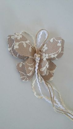 Αποτέλεσμα εικόνας για μπομπονιερα ρολοι πεταλουδα