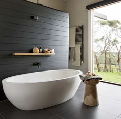 white freestanding bathtub, charcoal vj feature wall