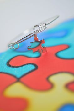 Happy Autism Awareness Month! Spread awareness and acceptance with a puzzle charm bracelet