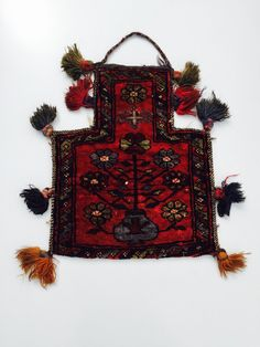 Who would like this hanging on their crisp white walls....a genuine antique afghan salt bag!  Perfect for wall hanging or accessory...let your imagination run wild!!  Measures approx 25cm by 45cm
