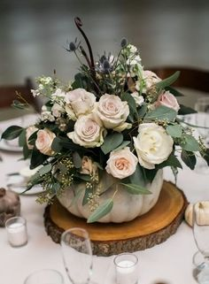Fall wedding centerpiece idea - pumpkin and floral wedding centerpiece on tree slice {FMGC} wedding table decor FMGC - Flowers - Chicago, IL - WeddingWire Fall Wedding Centerpieces, Pumpkin Centerpieces, Fall Wedding Flowers, Wedding Flower Arrangements, Floral Centerpieces, Floral Wedding, Diy Wedding, Centerpiece Ideas, Pumpkin Floral Arrangements