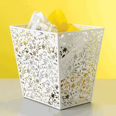 Use decorative aluminum panels to create this look.Choose a small decorative trashcan like this, white vinea trashcan. The small size  makes it a perfect match for using grocery bags as trashcan liners.