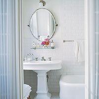 Elle Decor - bathrooms - vintage glass shelf, glass shelf over sink, glass shelf above sink, pedestal sink, oval pivot mirror, beveled subway tile, beveled subway tile backsplash, white bathroom, white bathroom ideas,