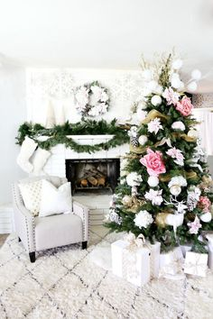 Christmas Tree Decoration Ideas - Stunning feminine tree with sheer gold garland, oversized pink flowers, giant frosted pinecones, and large white ornaments—Holiday decor #GOALS.