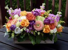 A pretty lush flower arrangement in a rustic wooden container. A pretty lush fl Big Flowers, Fresh Flowers, Spring Flowers, Flowers Garden, Tropical Flowers, Flower Canvas Art, Flower Art, Spring Flower Arrangements, Floral Arrangements