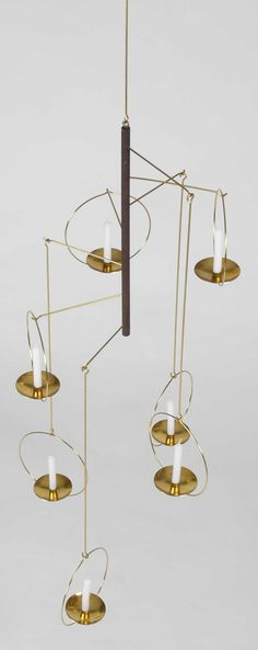 Timo Sarpaneva; Brass Candle Mobile for Raija Aarikka, 1950s/60s.