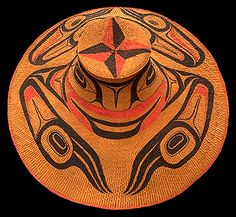 Haida; collected at Masset in 1911 by C. C. Perry; woven cedar bark. Early engravings by Russian artists depict north coast chiefs wearing woven hats painted with formline crest designs. Haida women excelled in basketry.  Isabella and Charles Edenshaw made painted hats for sale, including this example. The four-pointed star with bicolored points is the signature of Charles Edenshaw, who painted the hats.