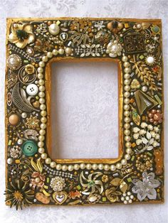 Cover a frame with Grandmas jewelry & fill the frame with her picture. Great idea to actually display her things instead of keeping them hiding in a drawer.