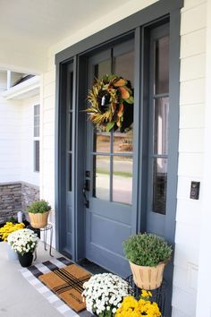 Today I wanted to share our simple front porch, along with other fall front porches for inspiration, great paint colors, and decor ideas. Front Door Porch, Exterior Front Doors, House Front Door, Grey Exterior, Exterior House Colors, Front Door Decor, Exterior Paint, Porch Doors, Front Door Paint Colors