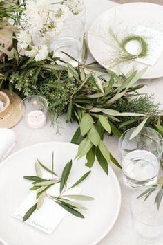 Tree branch center pieces. Eucalyptus, olive branches, rosemary, etc.
