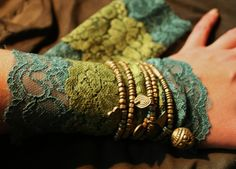 fairy pirate style romantic arm lace cuffs puls wrist warmers in dark and olive green lace. €13.00, via Etsy.