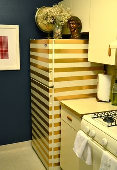 "Gold Striped Fridge (made of duct tape!)   This would be great for the ""extra"" fridge or in a bar/bonus room/basement"