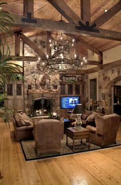 Everything about this! The beams, the lighting, the stone fireplace, the built ins for the TV.